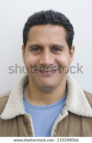 Portrait of a middle aged man smiling - stock photo
