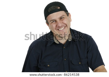 Portrait of a middle aged man wearing a cap and laughing - stock photo
