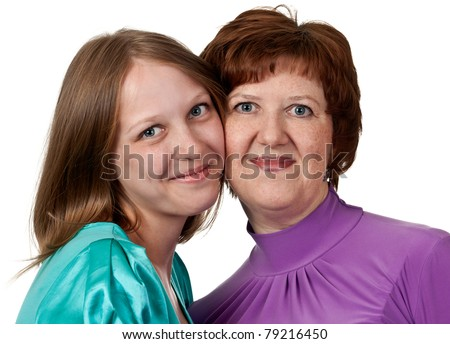 portrait of a middle-aged mother with a young daughter on a white background