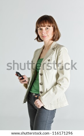 Portrait of a middle aged woman holding smartphone - stock photo