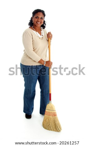 Portrait of a minority woman on white background cleaning - stock photo