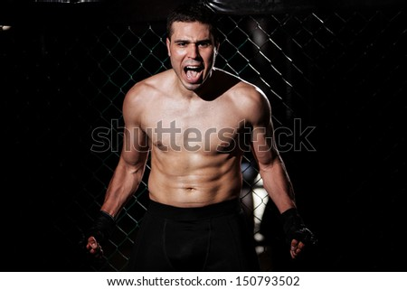 Portrait of a mixed martial arts fighter showing his anger to his opponents