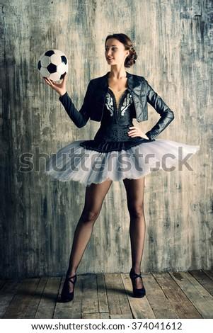 Portrait of a modern ballet dancer posing at studio over grunge background. Art concept. - stock photo