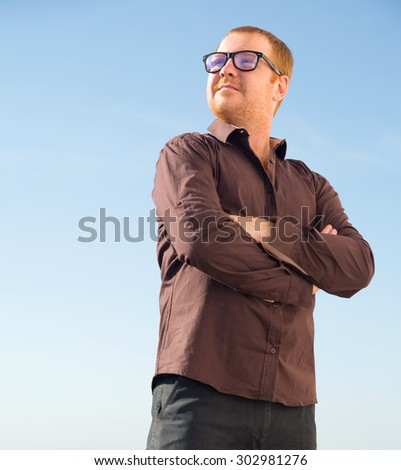 Portrait of a modern business person. Serious man. Confident mature man smiling. Outdoor portrait of handsome man posing at blue sky. Life style. Charismatic man glasses.  - stock photo