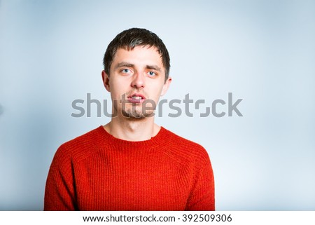 portrait of a modern free style businessman, isolated on a gray background - stock photo