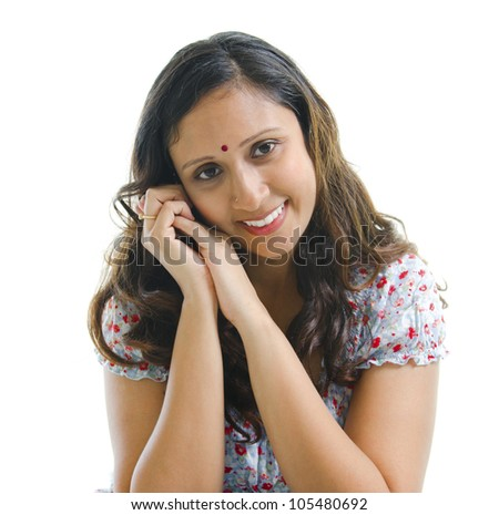 Portrait of a modern Indian woman smiling, isolated on white background - stock photo