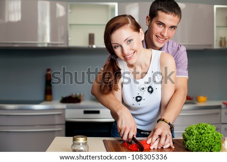 Portrait of a Modern romantic couple preparing a meal - stock photo
