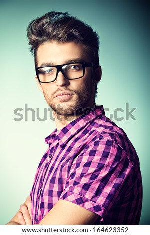 Portrait of a modern young man in spectacles.