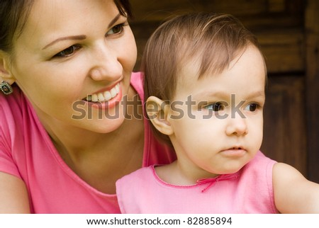 portrait of a mom and daughter at nature