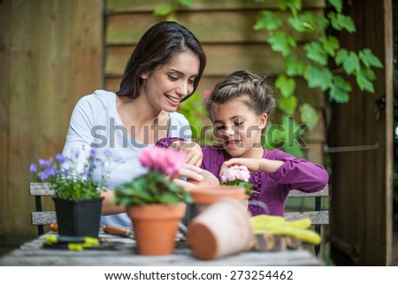 Portrait of a mother daughter special moment. Gardening discovering and teaching - stock photo