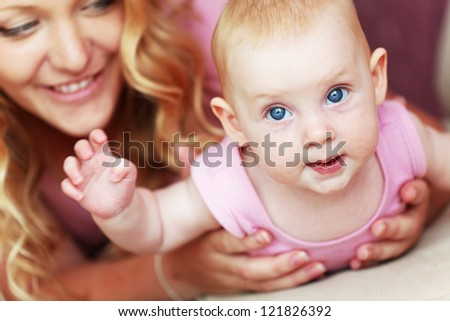Portrait of a mother with her baby daughter - stock photo