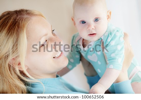 Portrait of a mother with her 4 months baby - stock photo