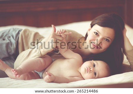 Portrait of a mother with her 4 months old baby - stock photo