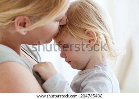 Portrait of a mother with her 2 years old child - stock photo