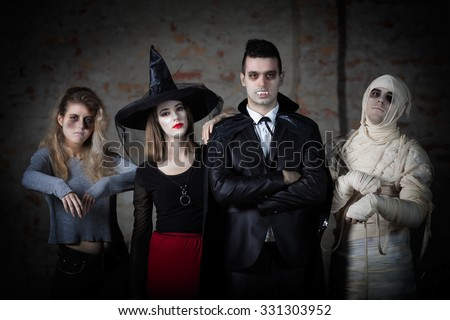 Portrait of a mummy, zombie, witch and a vampire ready for a Halloween party - stock photo