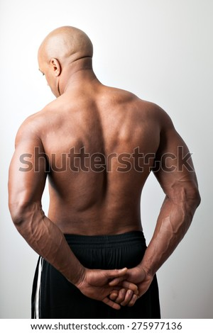Portrait of a muscle fitness mans back and shoulders. - stock photo