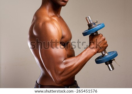 Portrait of a muscle man lifting weights - stock photo