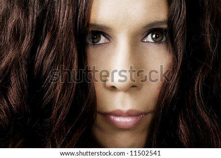 Portrait of a mysterious female with huge hair volume