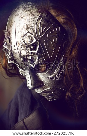 Portrait of a mysterious man in iron mask. Steampunk. Fantasy. Halloween. - stock photo