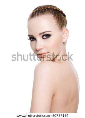 Portrait of a naked  woman with bright black make-up. Isolated on white - stock photo