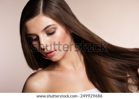 Portrait of a naturally beautiful girl with flawless perfect skin and shiny hair - stock photo
