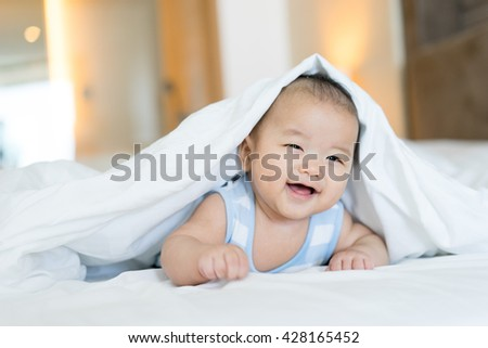 Portrait of a newborn Asian baby on the bed  - stock photo