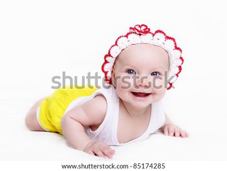 Portrait of a newborn baby girl indoors - stock photo