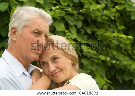 portrait of a nice elderly couple at  nature