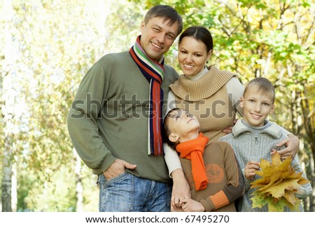 portrait of a nice family of four on the nature