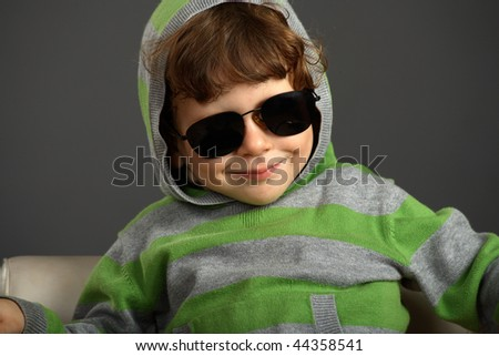 Portrait of a nice little boy with sunglasses