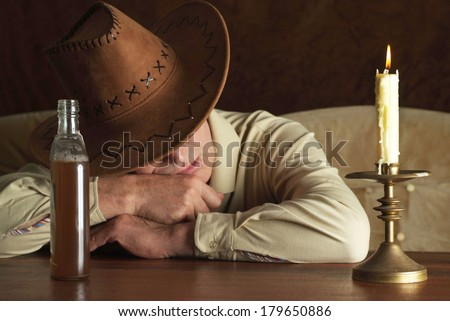 Portrait of a nice mature man in cowboy hat