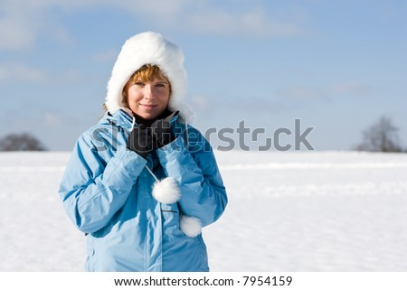 Portrait of a nice woman outdoor in the snow