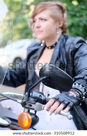Portrait of a nonconformist motorcyclist