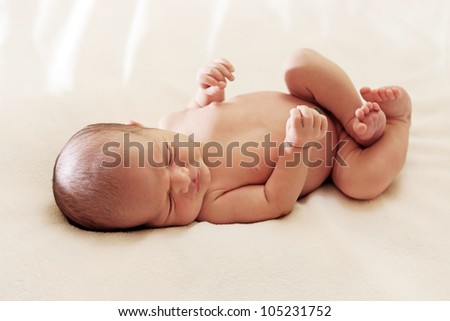 Portrait of a one week old baby boy asleep - stock photo