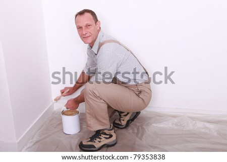 Portrait of a painter at work - stock photo