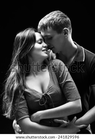 Portrait of a passionate couple - stock photo