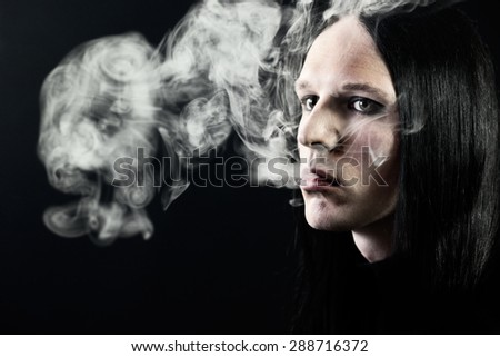 Portrait of a passionate smoker - stock photo