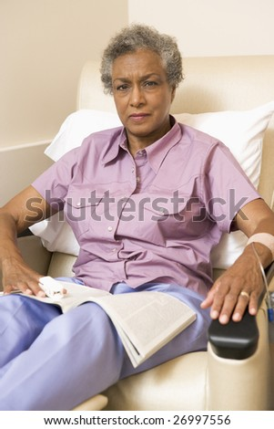 Portrait Of A Patient With A Magazine, whilst receiving Chemotherapy