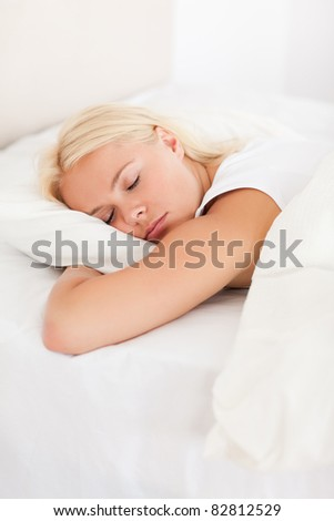 Portrait of a peaceful woman sleeping in her bedroom