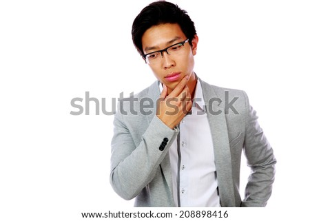 Portrait of a pensive asian man in glasses isolated on a white background - stock photo