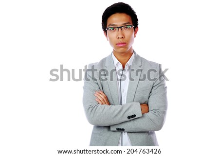 Portrait of a pensive asian man with arms folded isolated on a white background - stock photo