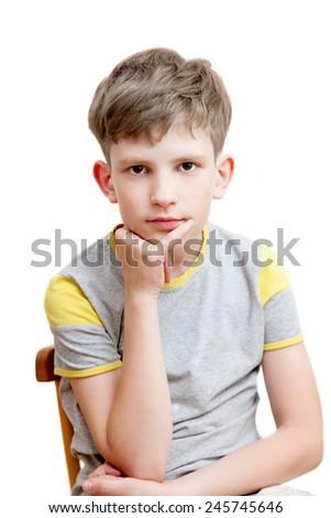 portrait of a pensive boy - stock photo