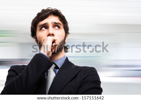 Portrait of a pensive businessman - stock photo