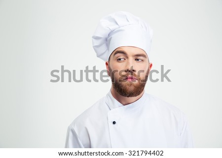Portrait of a pensive male chef cook looking away isolated on a white background - stock photo