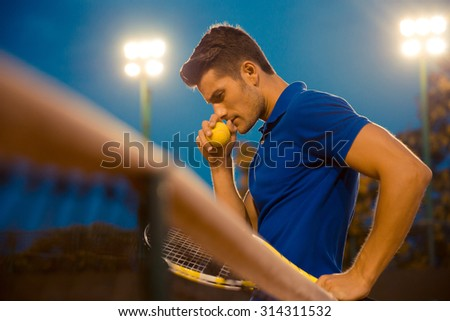 Portrait of a pensive tennis player standing outdoors - stock photo