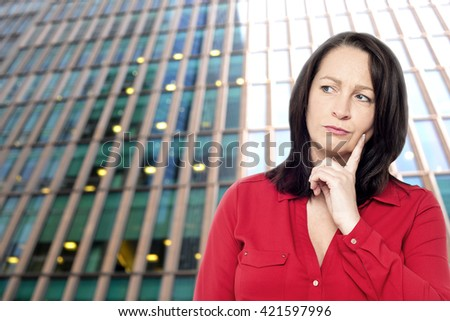Portrait of a pensive young in front of an building - stock photo
