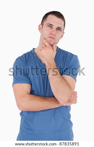 Portrait of a pensive young man against a white background - stock photo