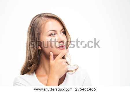 Portrait of a pensive young woman looking away isolated on a white background - stock photo