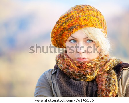 Portrait of a pensive young woman outdoor in the countryside. - stock photo