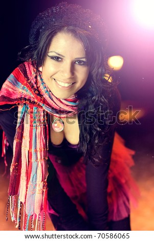 Portrait of a perfect brunette beauty smiling - stock photo